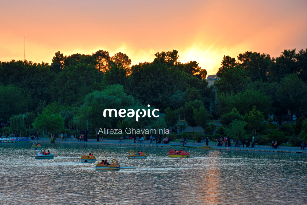 Group Of People In A Large Body Of Water Stock Photo · Meapic