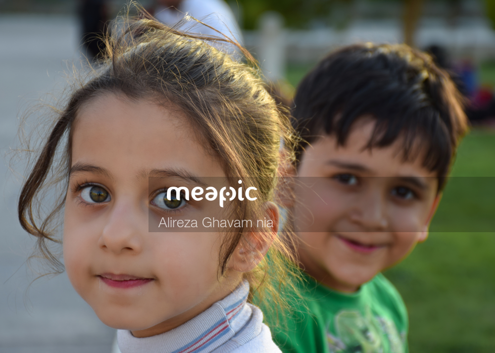 Little Girl Smiling At The Camera Stock Photo · Meapic