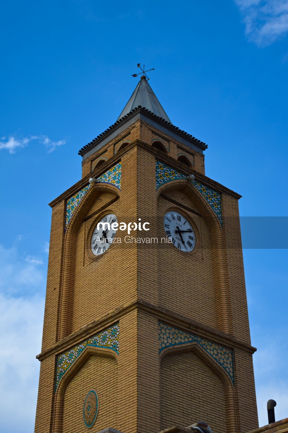 Large Brick Tower With A Clock On The Side Of A Building Stock Photo · Meapic