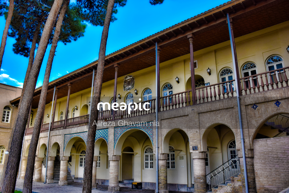 Group Of People In Front Of A Building Stock Photo · Meapic