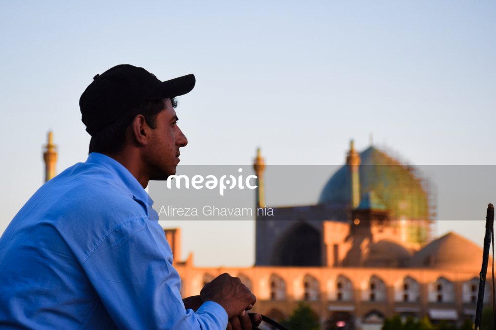 Man Standing In Front Of A Building Stock Photo · Meapic