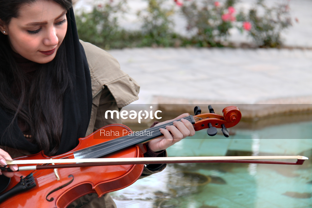 Person Riding On The Back Of A Violin Stock Photo · Meapic
