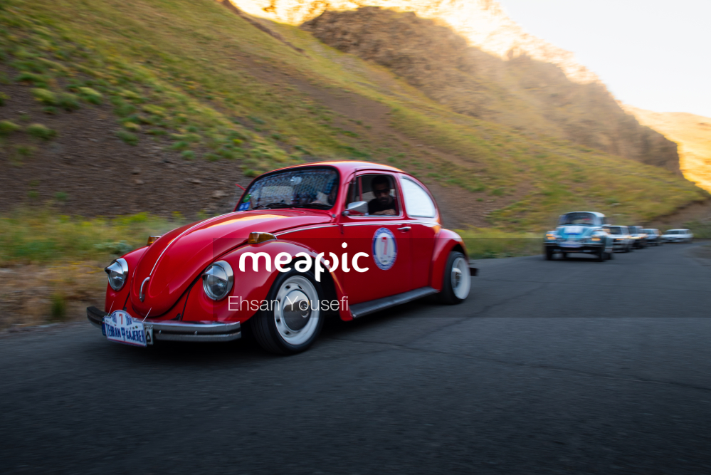 Car Driving On A Mountain Road Stock Photo · Meapic