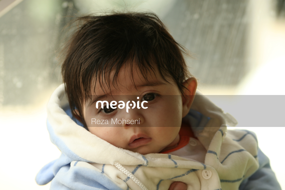 Person Holding A Baby Stock Photo · Meapic