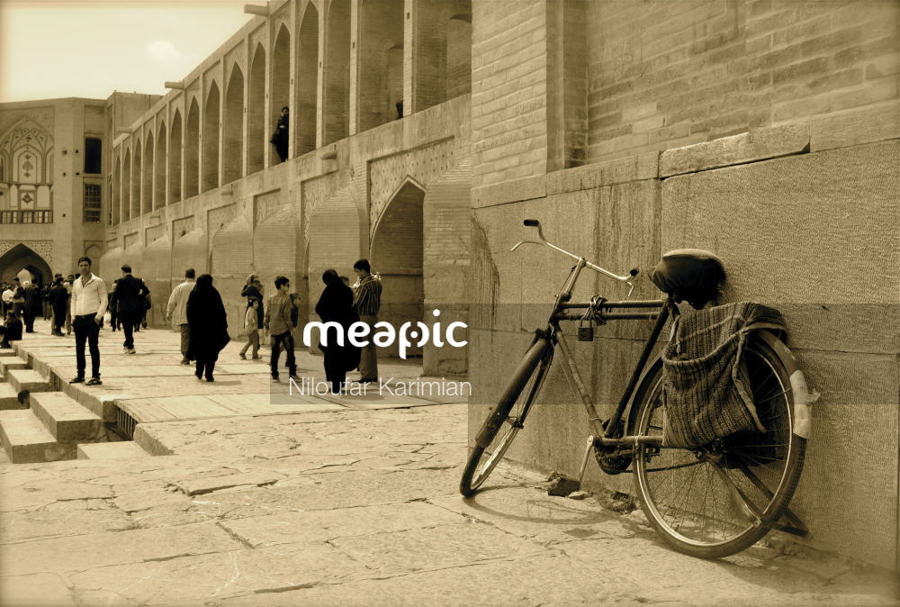 Group Of People Walking Down A Street Next To A Building Stock Photo · Meapic