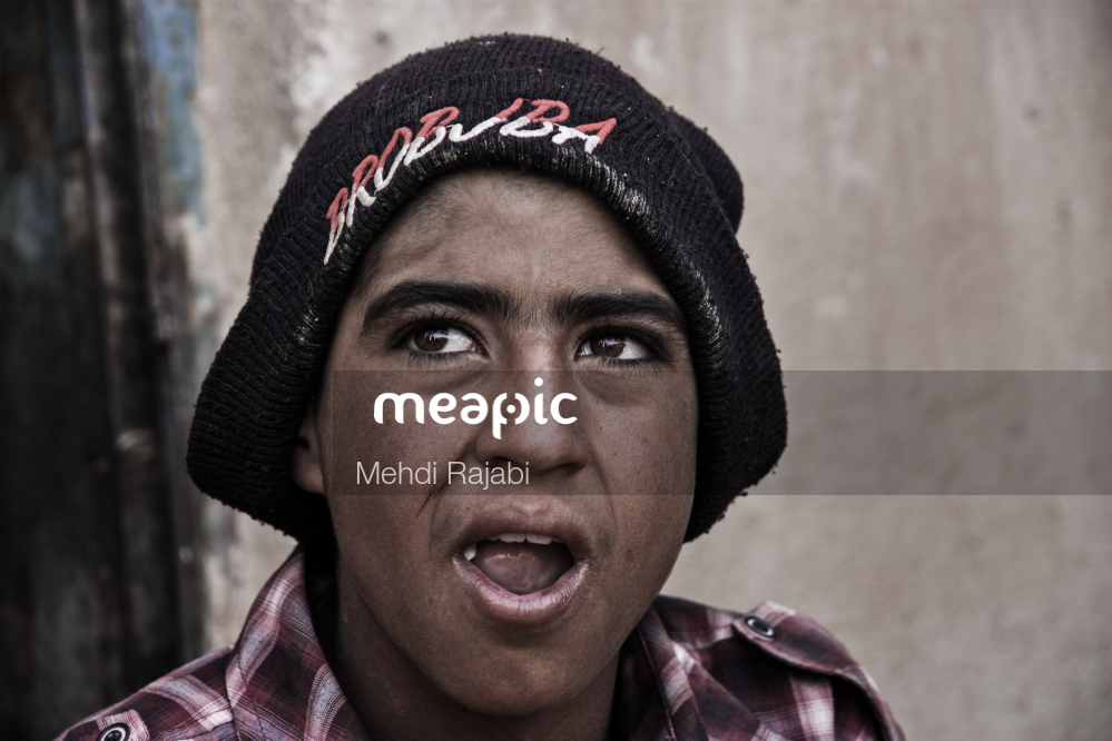Man Wearing A Hat And Smiling At The Camera Stock Photo · Meapic