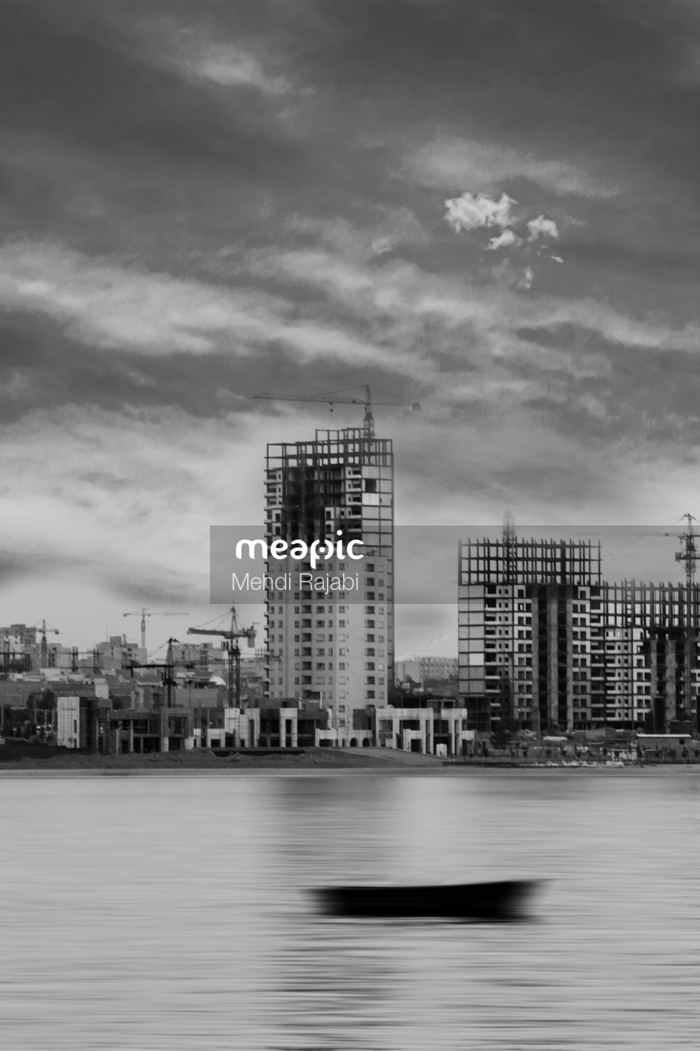 Body Of Water With A City In The Background Stock Photo · Meapic