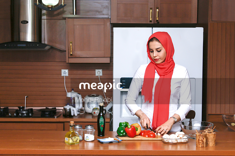 Person Sitting On A Kitchen Counter Stock Photo · Meapic