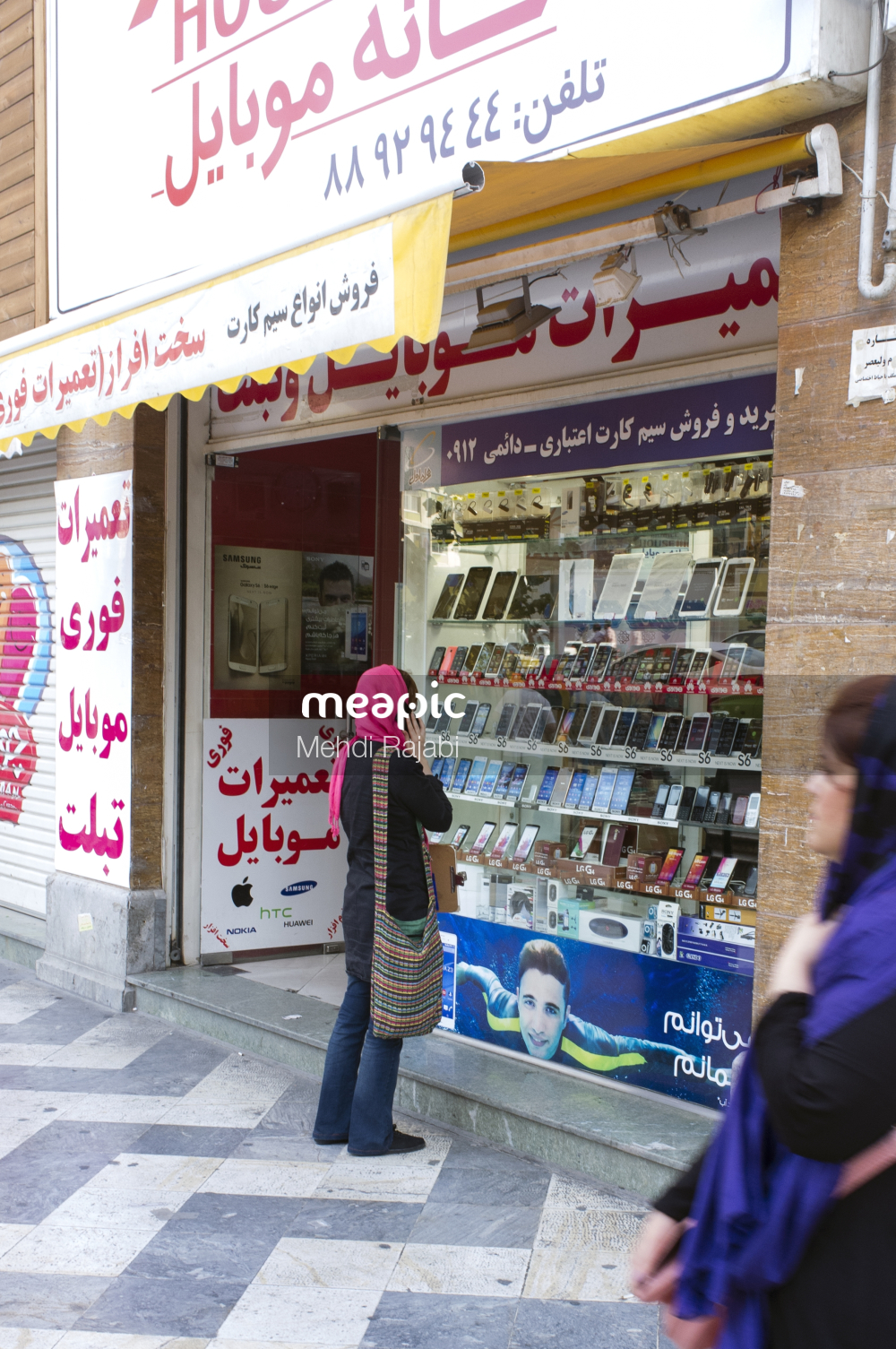Person Standing In Front Of A Store Stock Photo · Meapic