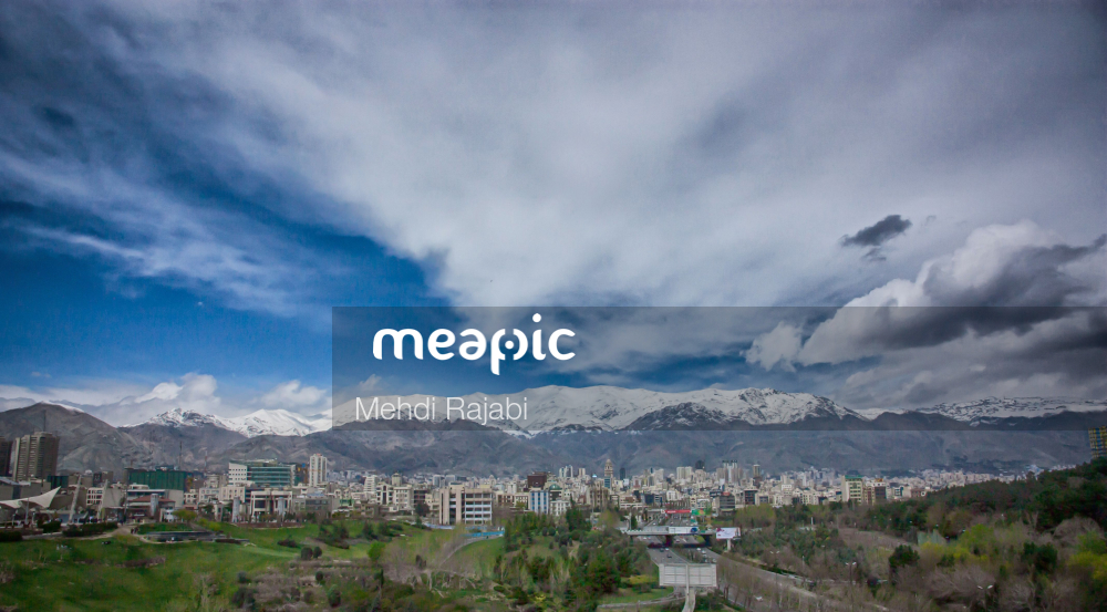 View Of A City With A Mountain In The Background Stock Photo · Meapic