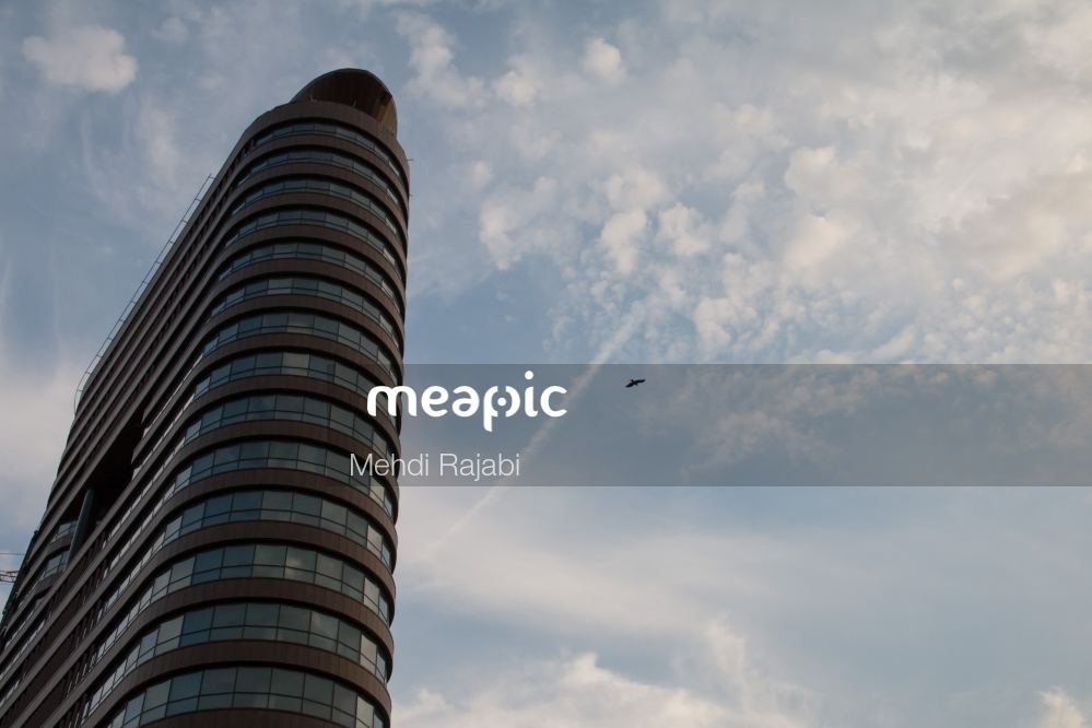 Large Tall Tower With A Cloudy Blue Sky Stock Photo · Meapic