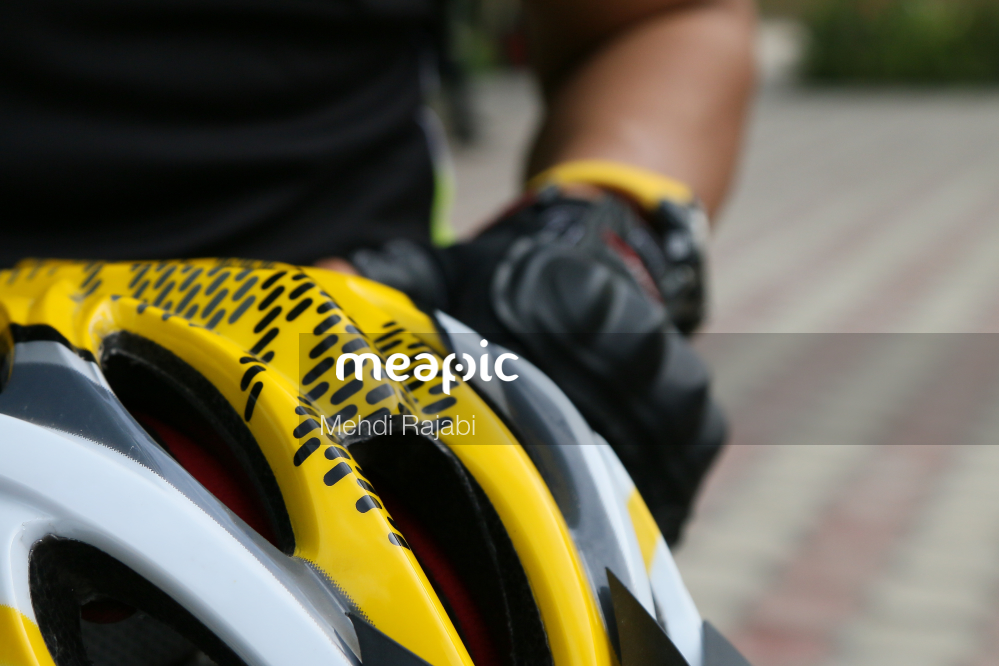 Yellow Helmet On A Motorcycle Stock Photo · Meapic