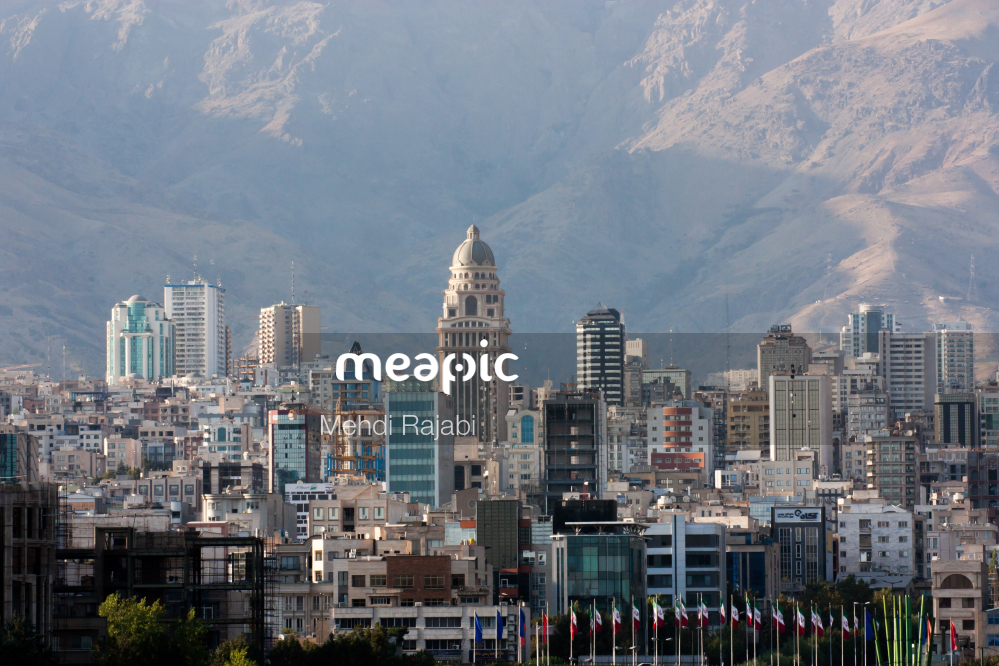 View Of A City Skyline With A Mountain In The Background Stock Photo · Meapic