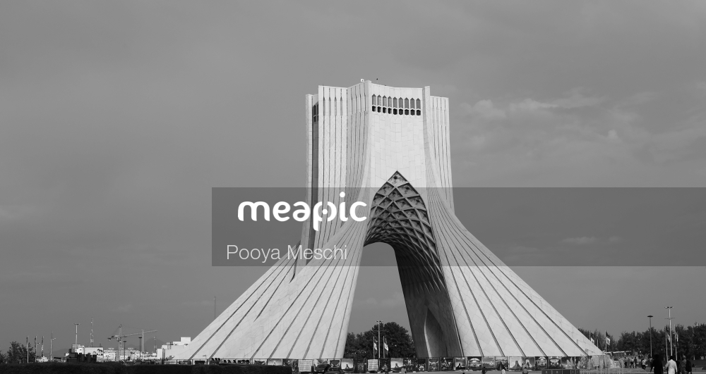 Large White Building With Azadi Tower In The Background Stock Photo · Meapic
