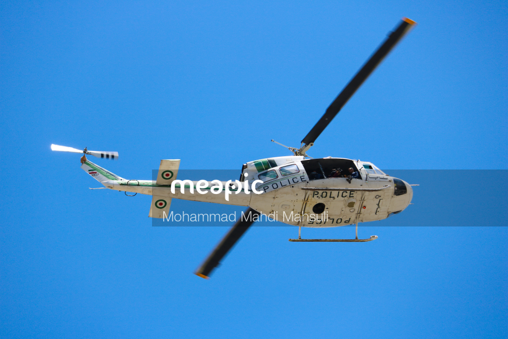 Helicopter Flying In The Clear Blue Sky Stock Photo · Meapic