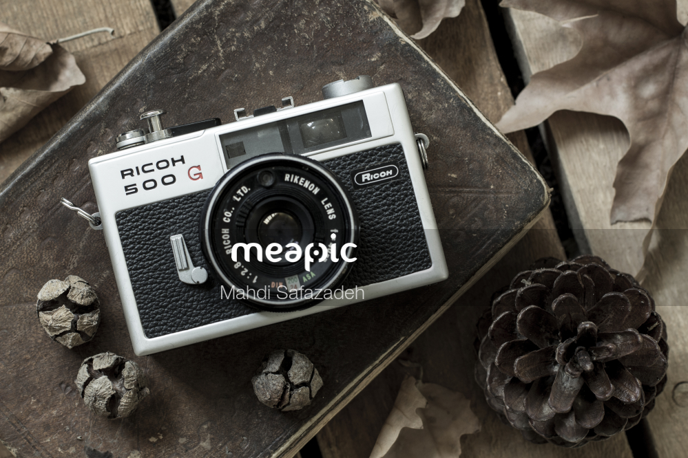 Camera On A Table Stock Photo · Meapic