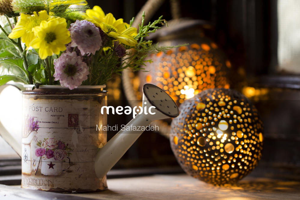 Vase Of Flowers On A Table Stock Photo · Meapic