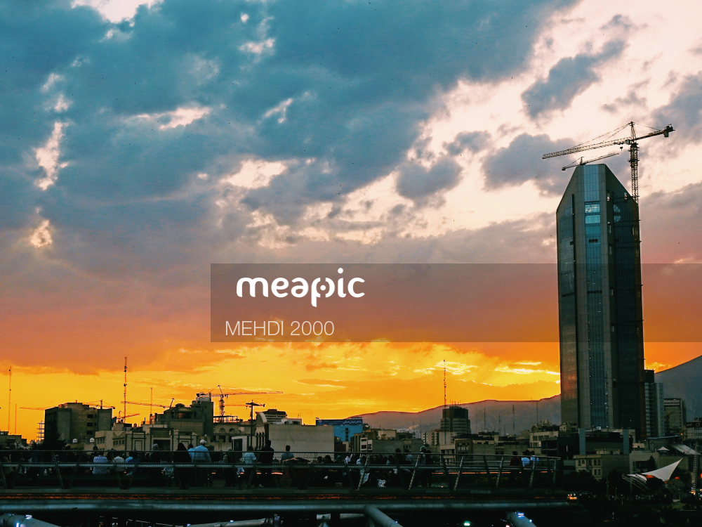 View Of A City At Sunset Stock Photo · Meapic