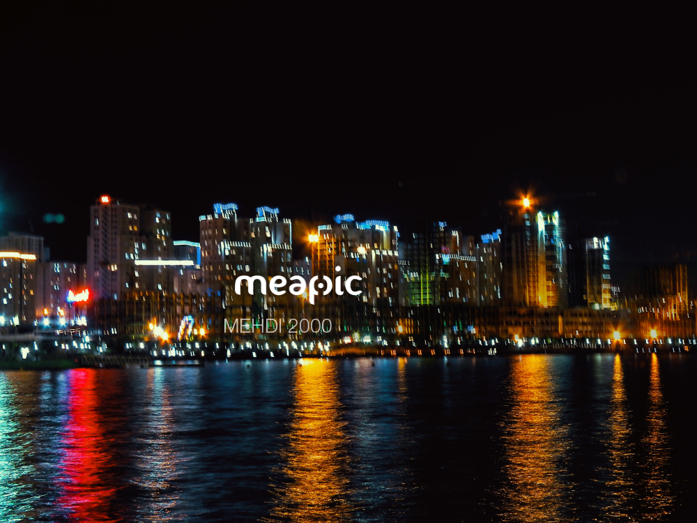 Body Of Water With A City In The Night Sky Stock Photo · Meapic