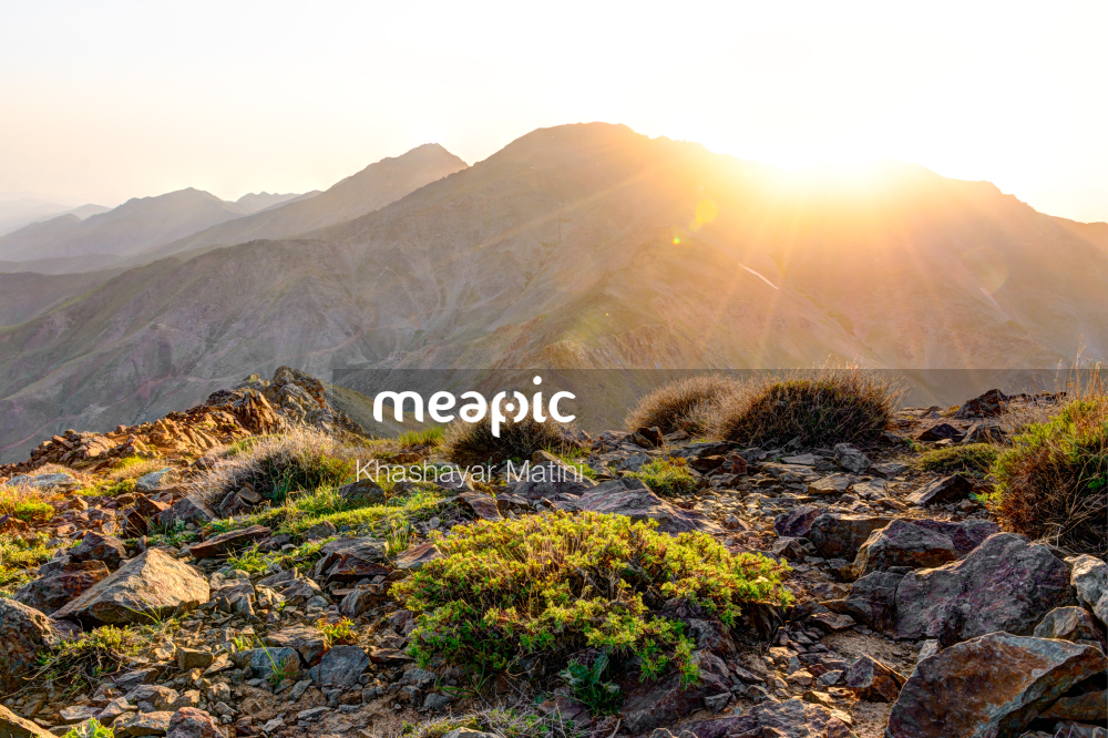 Person Standing On A Rocky Hill Stock Photo · Meapic