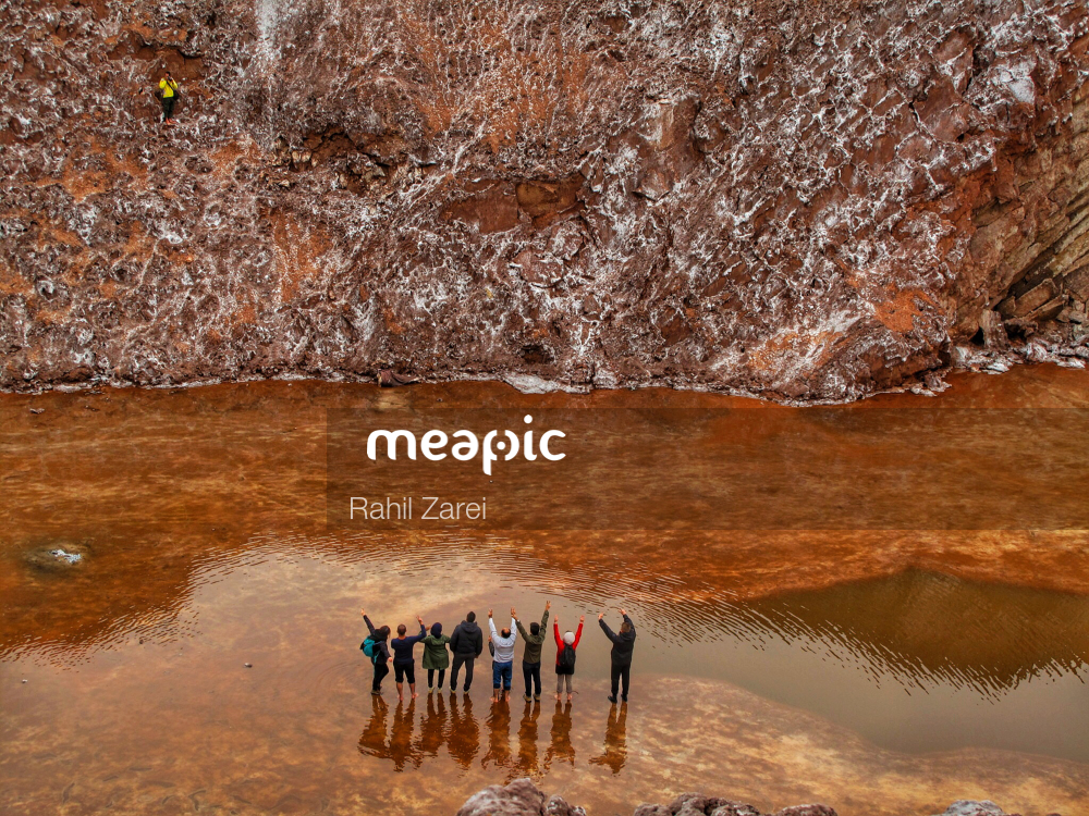 Group Of People That Are Standing In The Water Stock Photo · Meapic