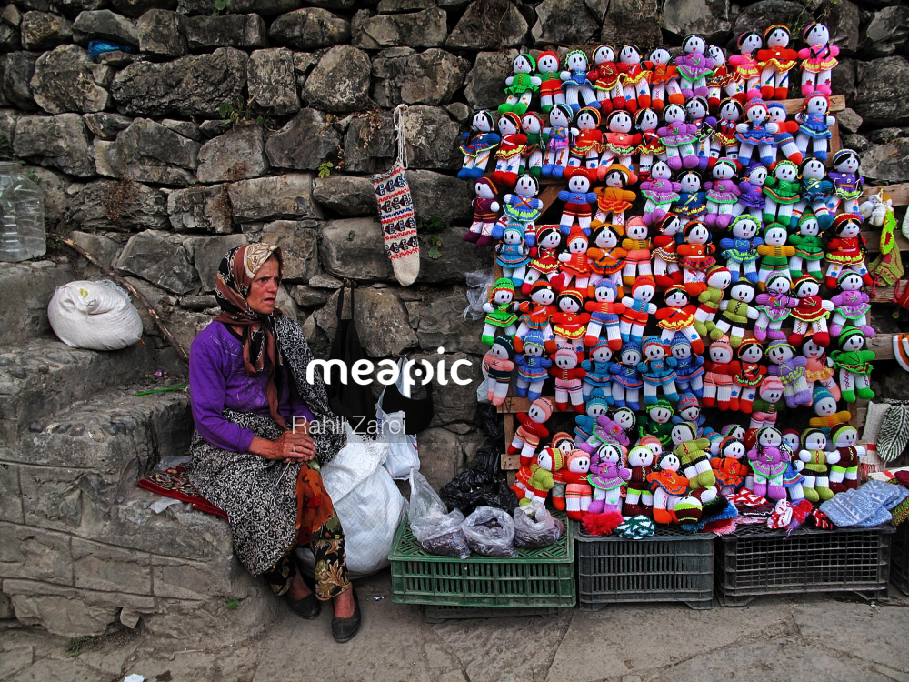 Pile Of Stuffed Animals Sitting Next To A Stone Wall Stock Photo · Meapic