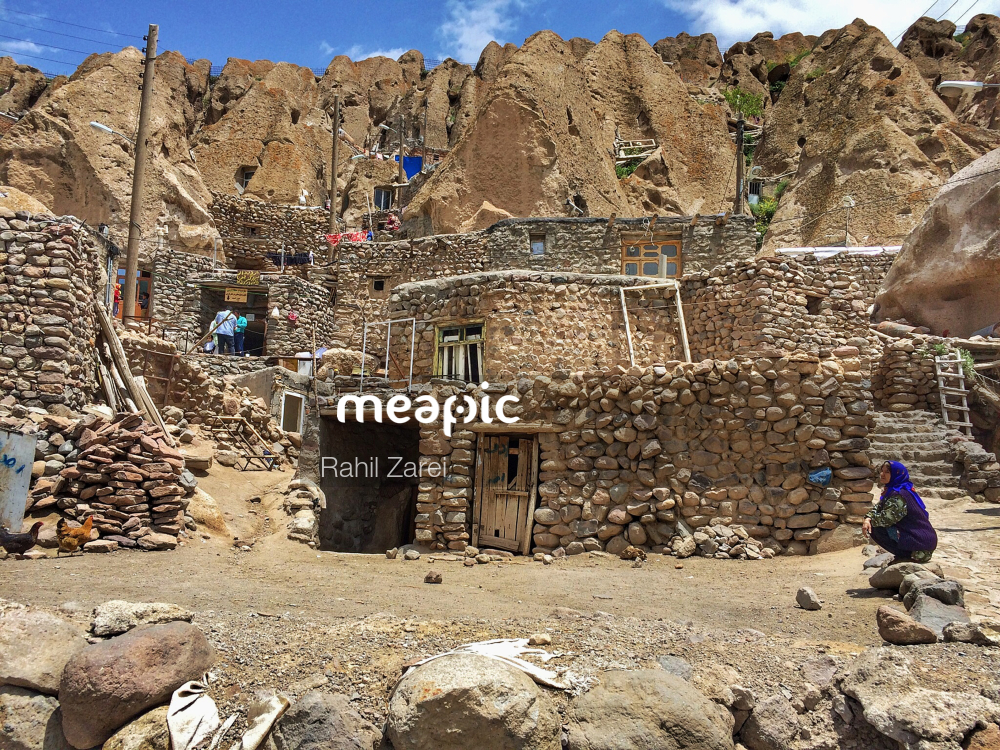 Group Of People Standing In A Rocky Area Stock Photo · Meapic