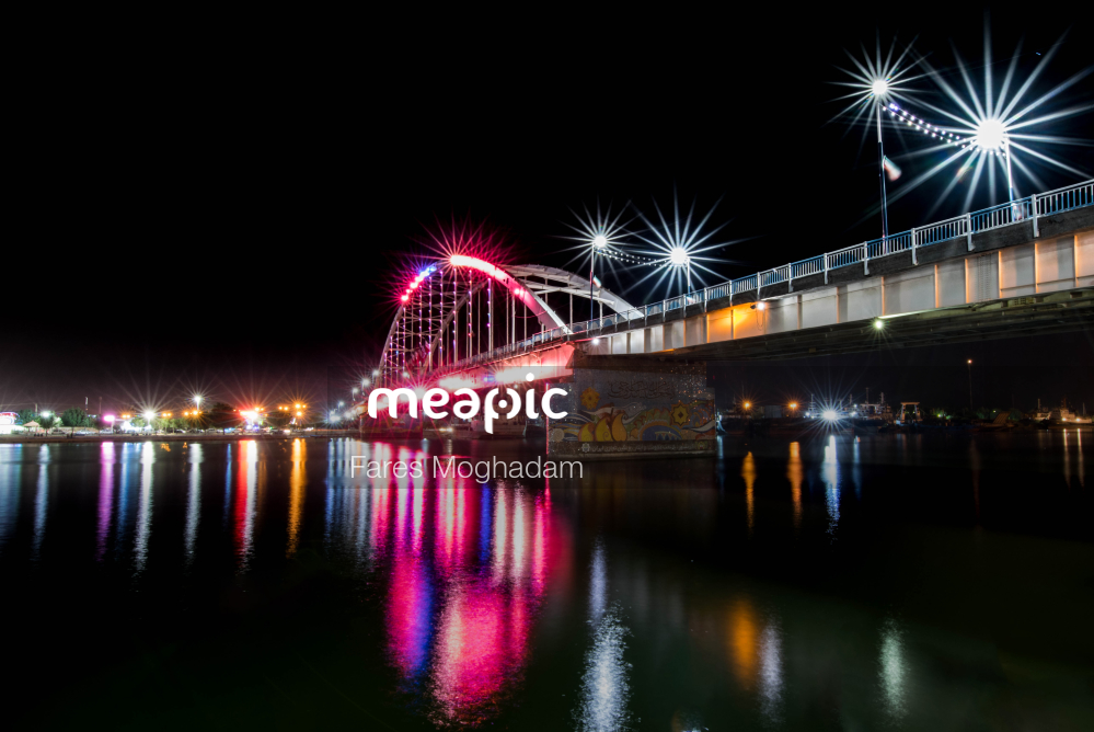 Bridge Over A Body Of Water At Night Stock Photo · Meapic