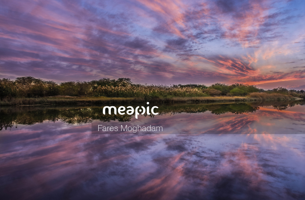 Clouds In The Sky Over A Body Of Water Stock Photo · Meapic