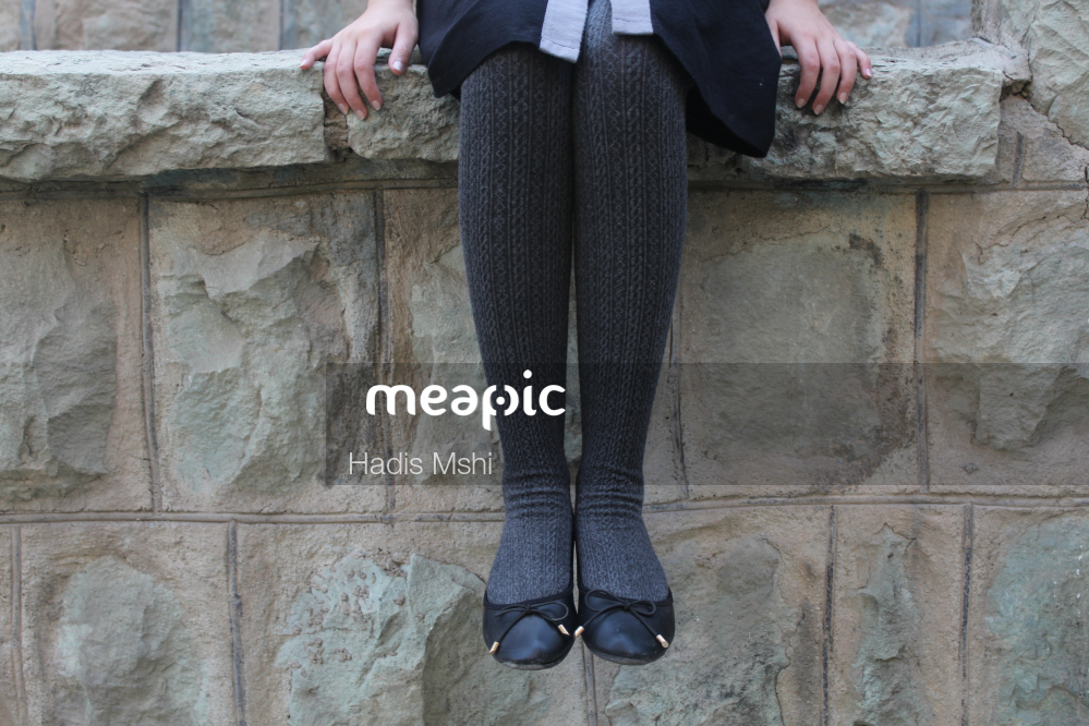 Person Standing In Front Of A Stone Building Stock Photo · Meapic