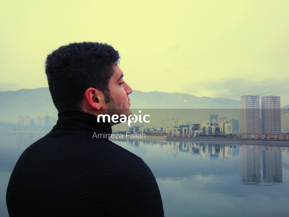 Man Standing In Front Of A Body Of Water Stock Photo · Meapic