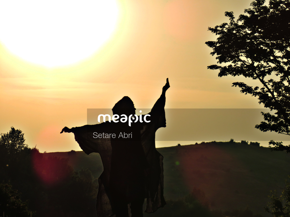 Group Of People Standing In Front Of A Sunset Stock Photo · Meapic