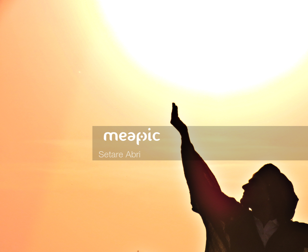 Person Standing In Front Of A Sunset Stock Photo · Meapic