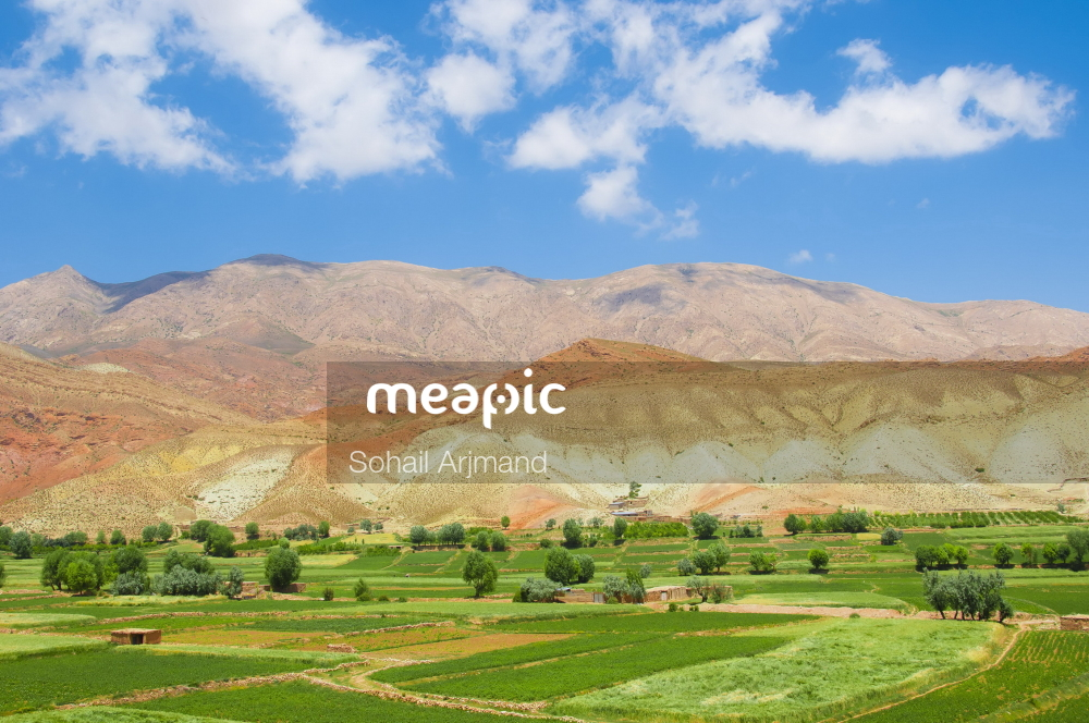 Field With A Mountain In The Background Stock Photo · Meapic