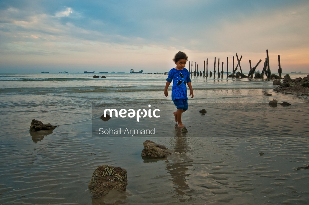 Young Boy Standing On A Beach Stock Photo · Meapic