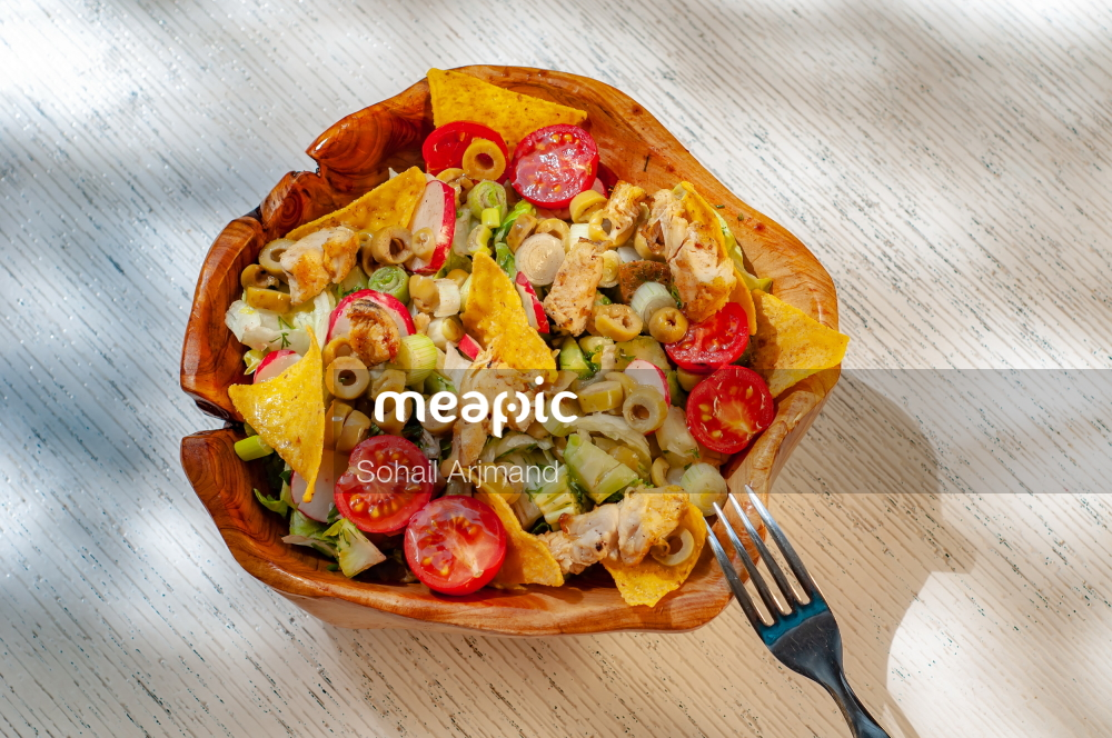 Pizza Sitting On Top Of A Wooden Table Stock Photo · Meapic
