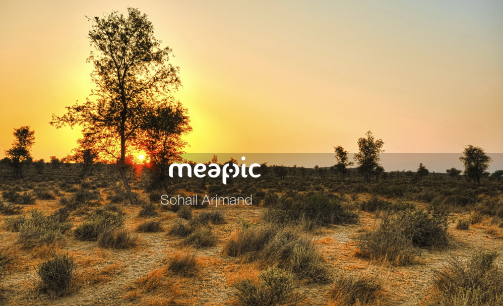 Sunset Over A Grass Field Stock Photo · Meapic