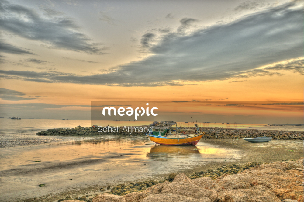 Boat On A Beach Near A Body Of Water Stock Photo · Meapic