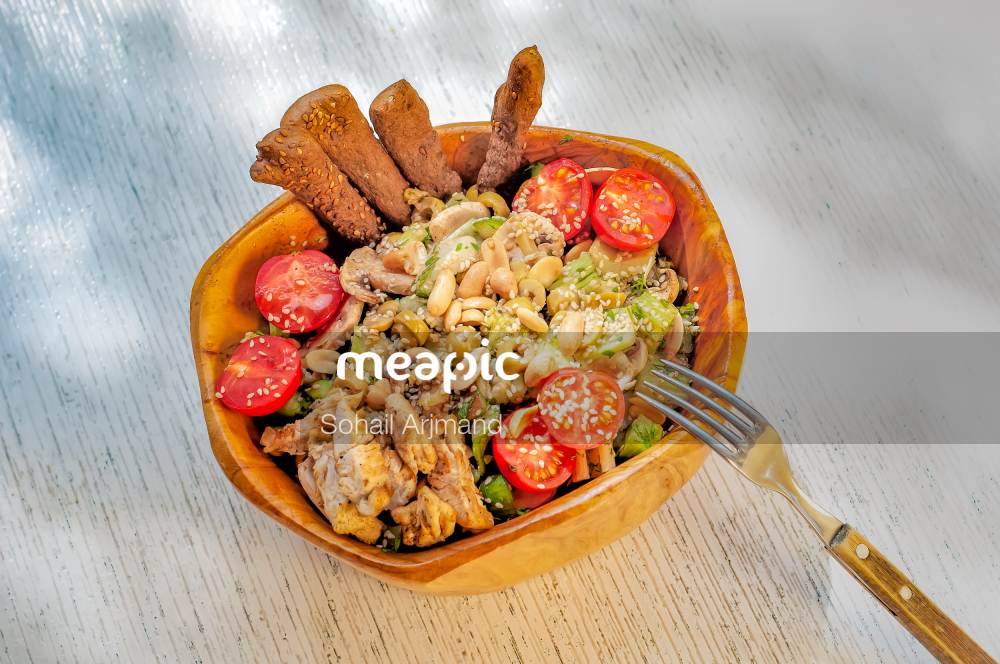 Plate Of Food Sitting On Top Of A Wooden Table Stock Photo · Meapic