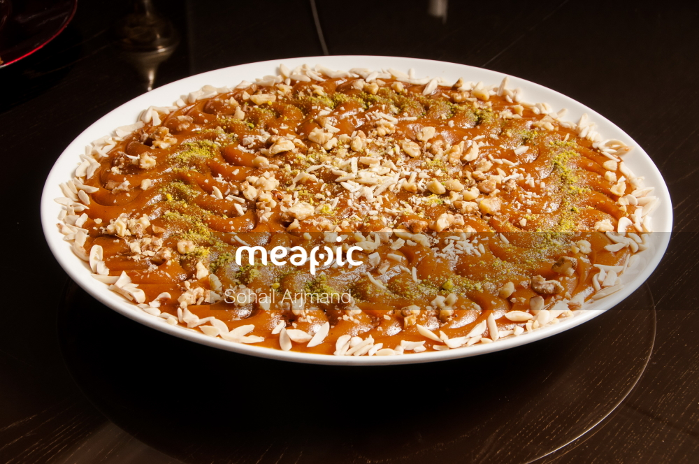 Bowl Of Food On A Plate Stock Photo · Meapic