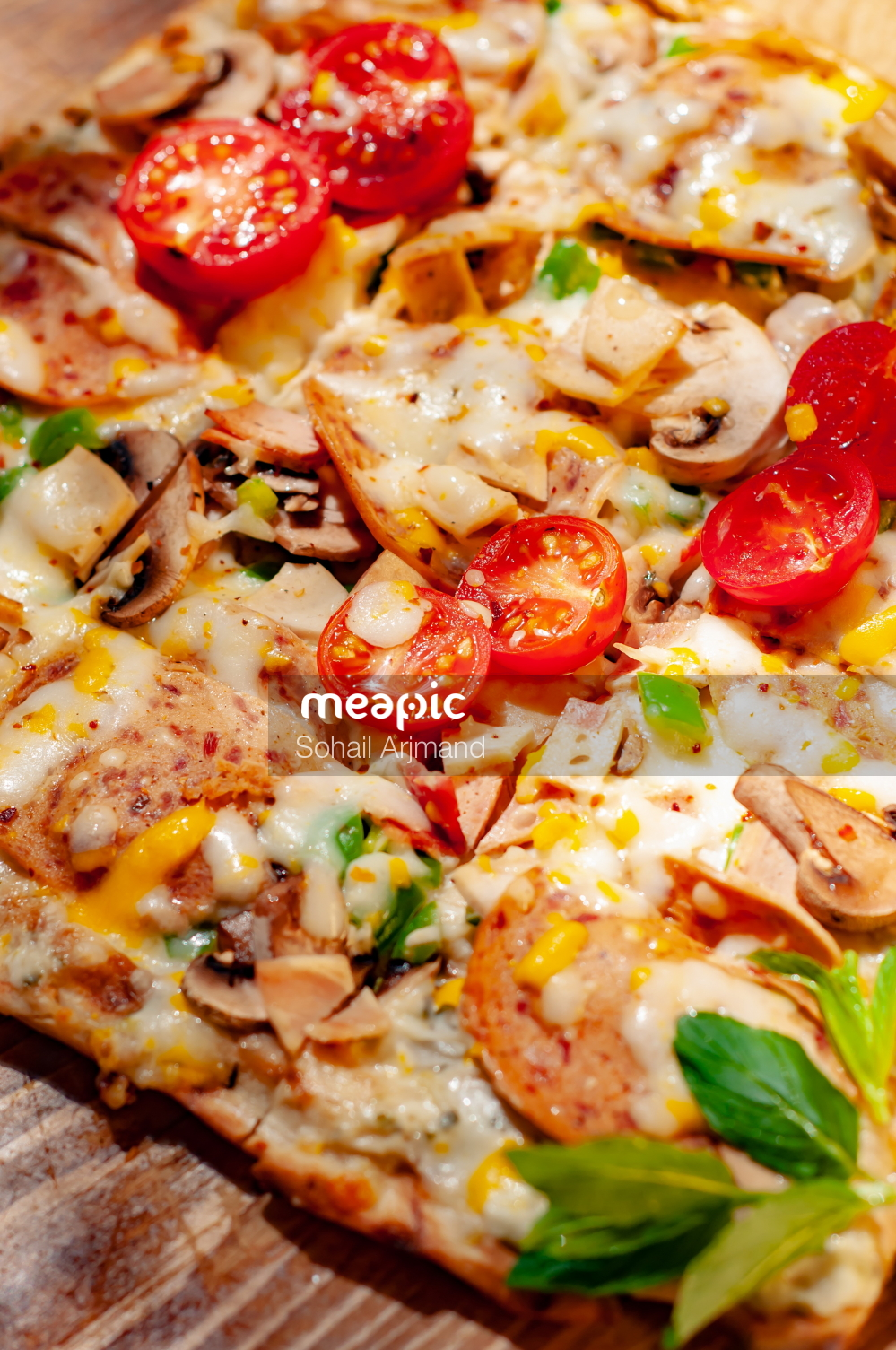 Close Up Of A Slice Of Pizza Stock Photo · Meapic