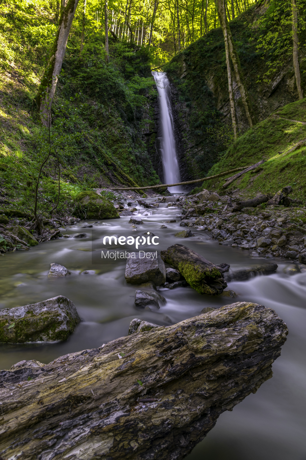 Large Waterfall Over A Rocky Cliff Stock Photo · Meapic