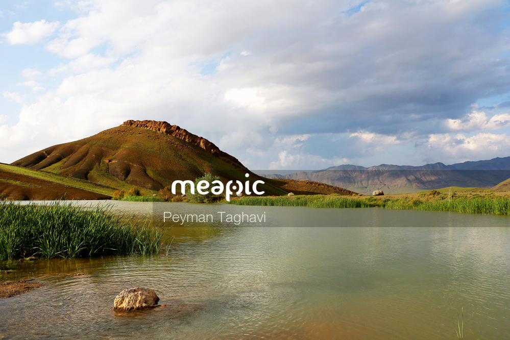Body Of Water With A Mountain In The Background Stock Photo · Meapic