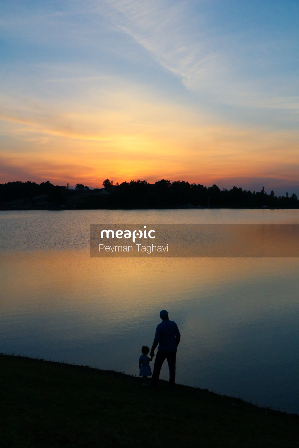 Sunset Over A Body Of Water Stock Photo · Meapic