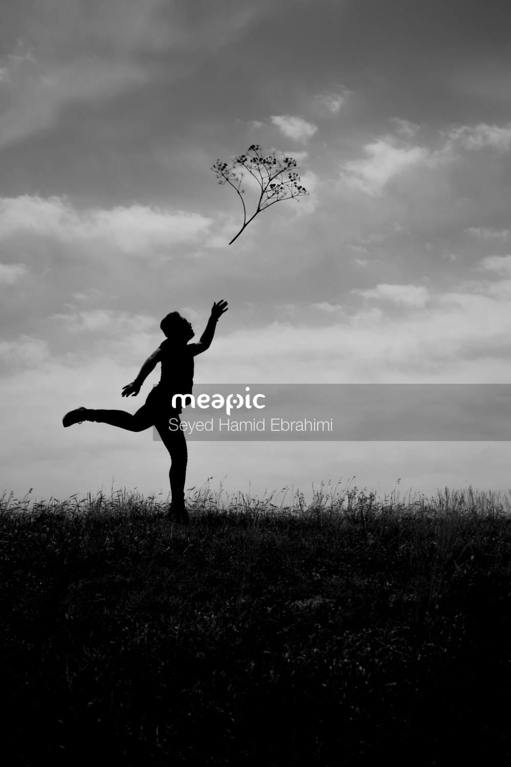 Person Flying Through The Air On A Cloudy Day Stock Photo · Meapic