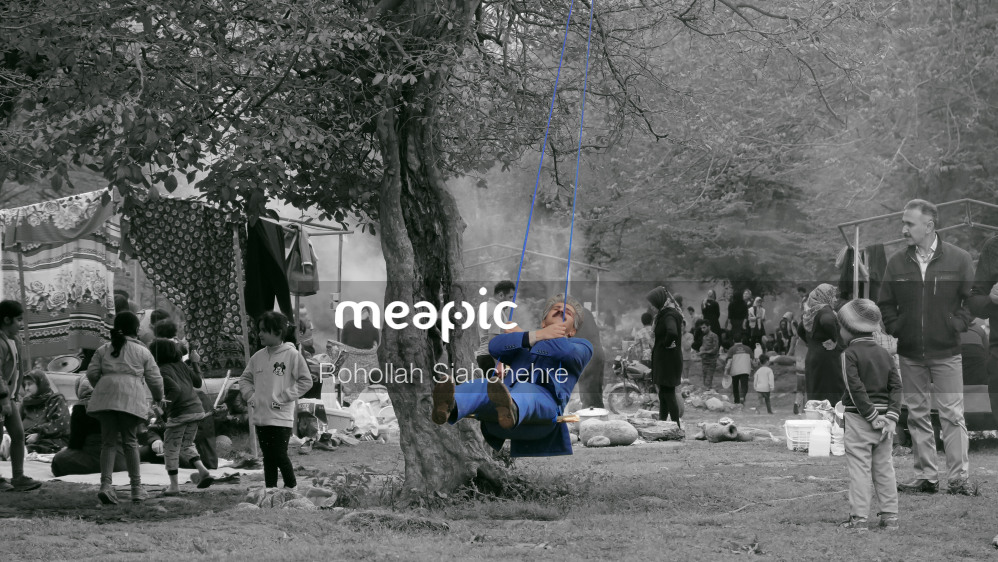 Group Of People In A Park Stock Photo · Meapic