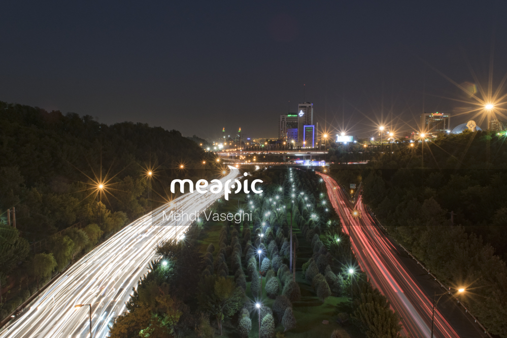 Train On The Tracks At Night Stock Photo · Meapic