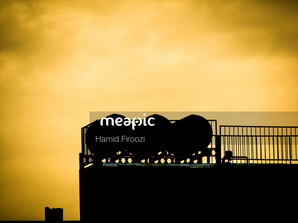 Sunset Over A City Stock Photo · Meapic