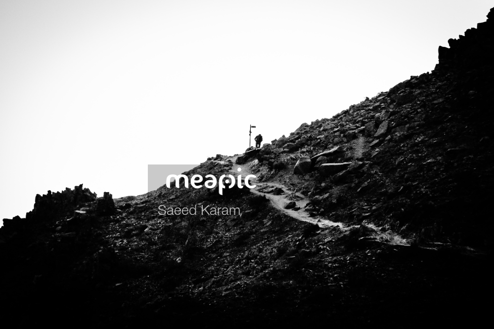 Person Flying Through The Air On A Mountain Stock Photo · Meapic