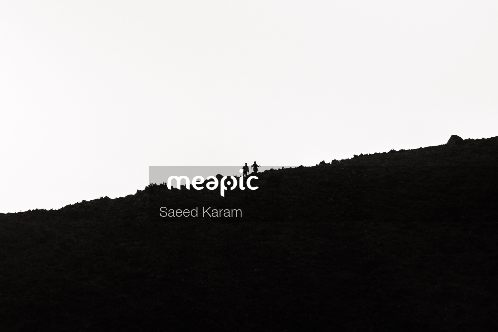 Man Standing In Front Of A Mountain Stock Photo · Meapic